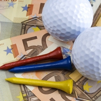 Golf balls and tees on Euros